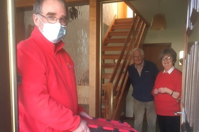 Food Train volunteer Alan McLachlan making a delivery to Robert and Maureen Clark of Stranraer