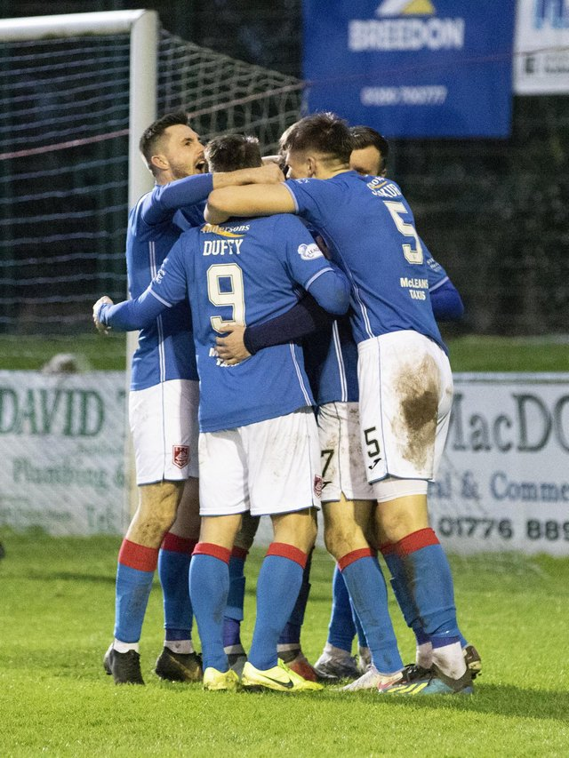 Stranraer players celebrate a goal in their League 2 encounter with Albion Rovers back in December (Pic: Bill McCandish)