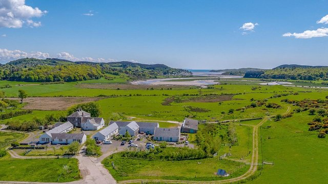 Theenterprise includesa collection of 10 holiday cottages, farmhouse and 200 acres of land