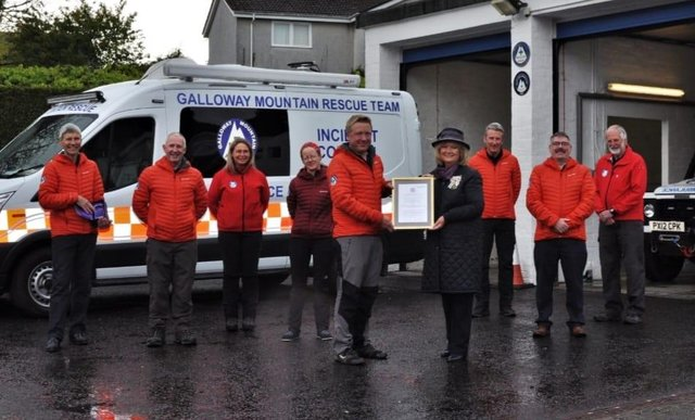 The Lord Lieutenant of Wigtown, Aileen Brewis,  presents the Queen's Award for Voluntary Service to Galloway Mountain Rescue Team
