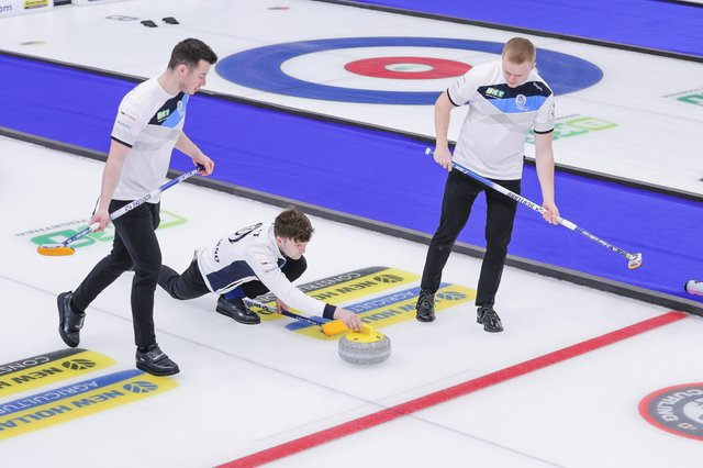 Hammy McMillan and Bobby Lammie keep an eye on things as skip Bruce Mouat delivers a stone during the World Championships (pic:WCF / Jeffrey Au 2021)