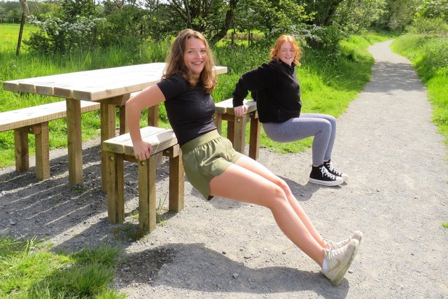 Amelia Craig andAmy Smith try out the triceps dip station