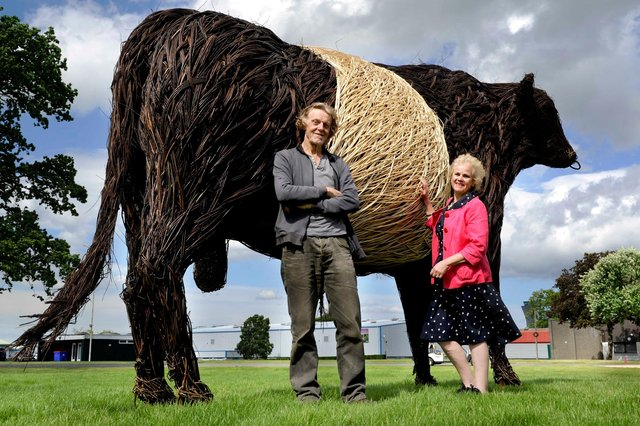 The wicker bull towers over Trevor Leat and Cathy Agnew