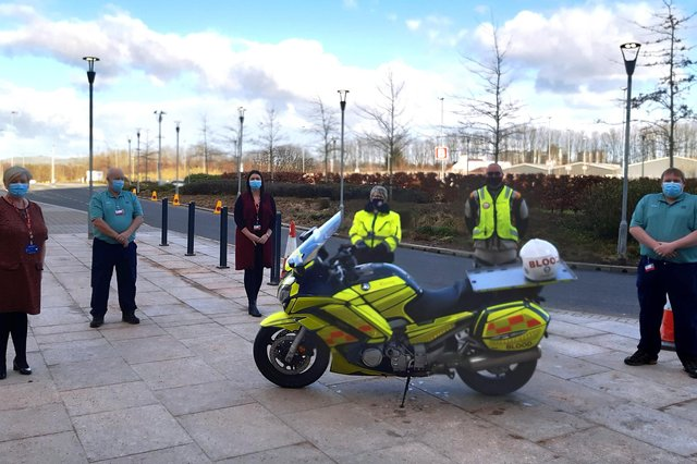 Judith Sauberlich and Bob Morrison from DG Blood Bikes with Serco staff