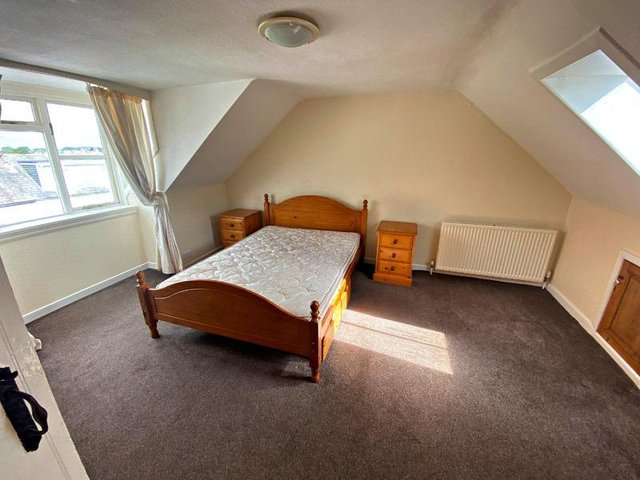 One of the three double bedrooms contained within the property