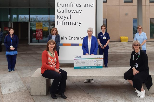 The Roddick family present the cheque outside Dumfries and Galloway Royal Infirmary